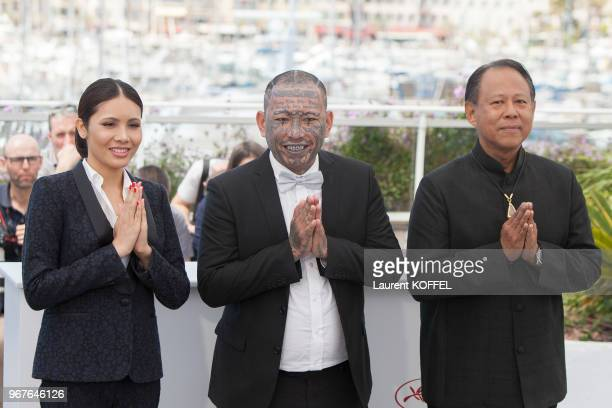 Pornchanok Mabklang Panya Yimumphai and director Vithaya Pansringarn attend the 'A Prayer Before Dawn' photocall during the 70th annual Cannes Film...