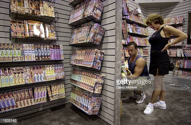 Porngraphic video tapes are on display at the fifth annual Erotica LA adult entertainment trade show July 14 2001 in Los Angeles CA The convention is...