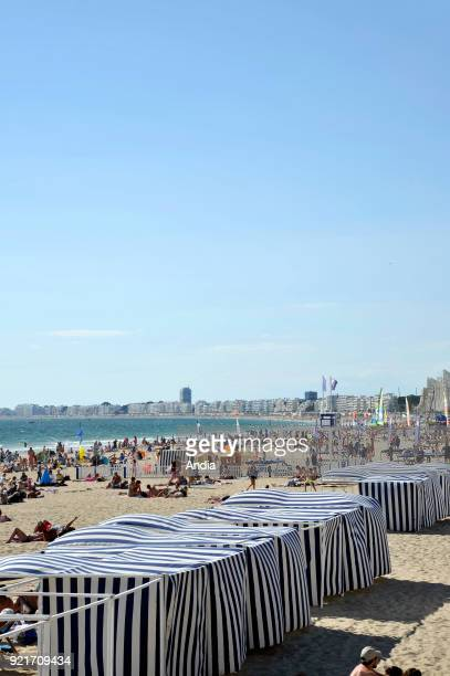 'plage des Libraires' beach in summer and the bay of La Baule in the background with buildings along the waterfront Holidaymakers on the beach and...