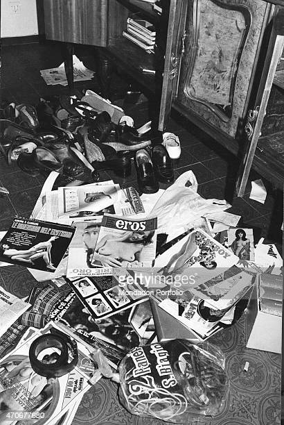 Porno magazines and shoes lying on the floor in Guido Badini's flat The man was Doretta Graneris' partner and he was involved in the Graneris...
