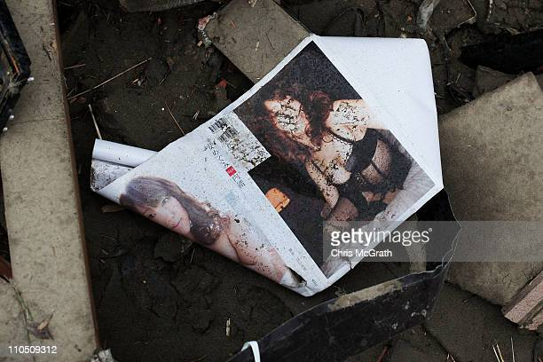 A pornographic magazine is seen amongst the rubble on March 20 2011 in Rikuzentakata Japan The 90 magnitude strong earthquake struck offshore on...