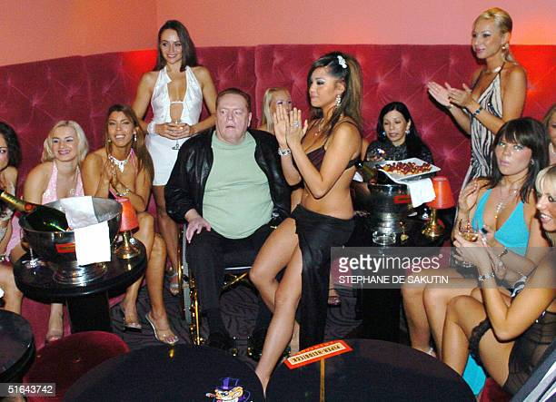 Pornography magnate Larry Flynt celebrates his 62nd birthday 01 November 2004 at a party at his strip club, the Hustler Club, in Paris.