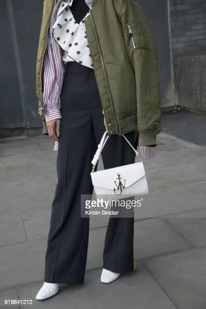 Pornwika Spierker wears a We Concept jacket JW Anderson bag Self Portrait top Mango trousers Kurt Geiger shoes on day one of London Womens Fashion...