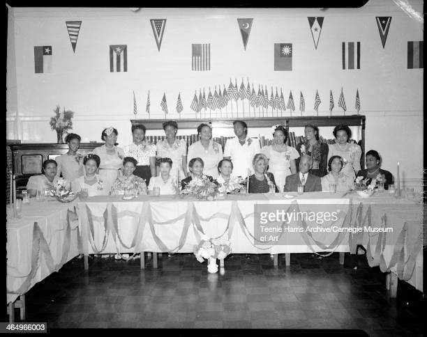 Poro Beauty School graduates posed at banquet table in Kay Boys' Club Pittsburgh Pennsylvania October 1 1945 Seated from left Fannie Wilson Mary D...