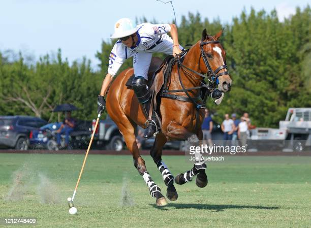 Poroto Cambiaso of Valiente brings the ball up field against Richard Mille during The Palm Beach Open on March 15 2020 at the Grand Champions Polo...
