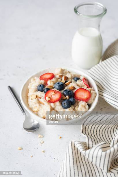 porridge oats with fresh berries - oatmeal stock pictures, royalty-free photos & images