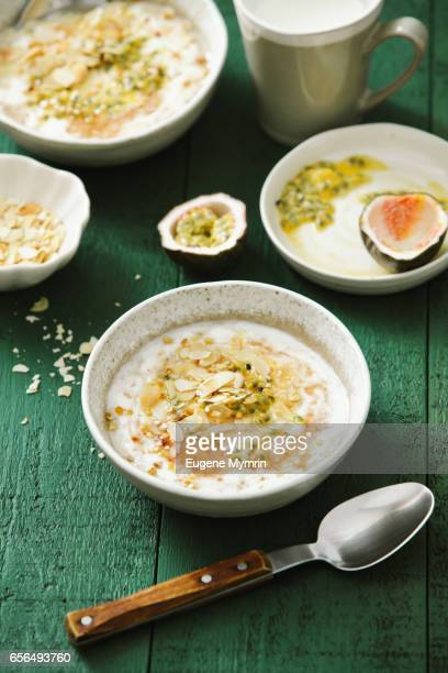 porridge with passion fruit and almond - rolled oats stock photos and pictures