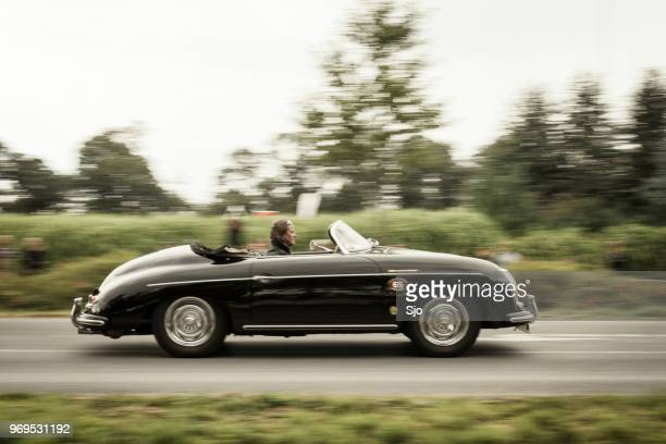 porsche 356 a convertible classic sports car driving fast - porsche stock pictures, royalty-free photos & images