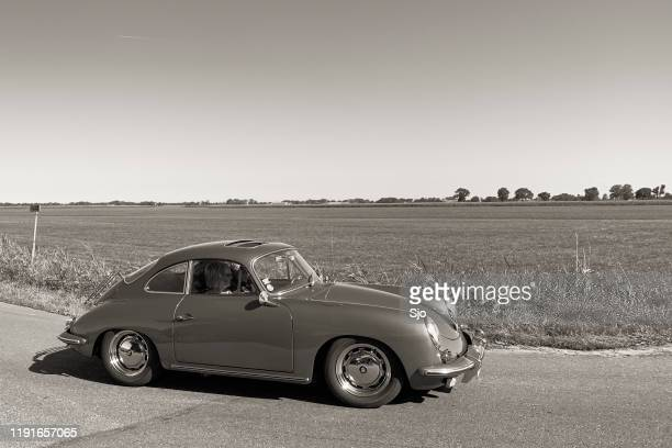 porsche 356 classic german sports car driving on a country road - history stock pictures, royalty-free photos & images