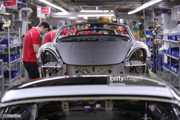 A Porsche 718 Boxster luxury automobile sits on the production line inside the Porsche AG factory in Stuttgart Germany on Tuesday Feb 19 2019...