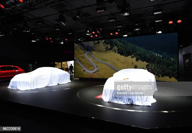 Porsche 718 Cayman GTS and 718 Boxter GTS are covered before they are unveiled during the auto trade show AutoMobility LA at the Los Angeles...