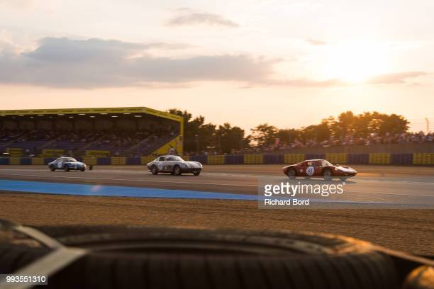 Porsche 904 Carrera GTS 1964 and a Ferrari 275 GTB 1964 compete during the Grid 4 Race 1 at Le Mans Classic 2018 on July 7 2018 in Le Mans France
