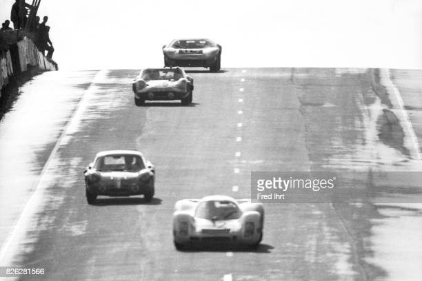 Porsche 908 on the race track racing Le Mans 1968 Gerhard Mitter Vic Elford #32 Le Mans 1968 24 hour endurance race Race car driver