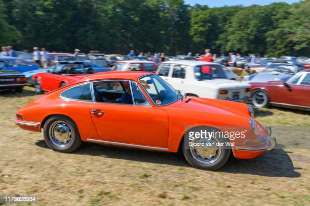 Porsche 911 2.0 1965 classic sports car driving on the parking lot at the 2019 Concours d'Elegance at palace Soestdijk on August 25, 2019 in Baarn,...