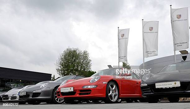 Porsche 911 automobiles sit on display at a dealership in Rosenheim Germany on Friday June 19 2009 Porsche SE may find its alliance with Qatar will...