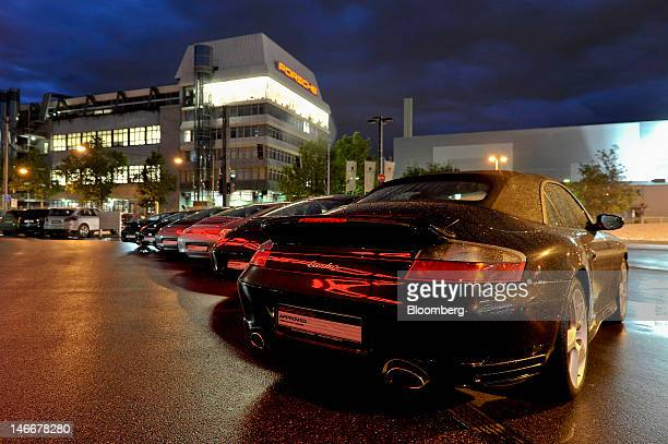 Porsche 911 automobiles stand outside the Porsche AG plant in Stuttgart Germany on Thursday June 21 2012 Porsche AG which is jointly owned by...