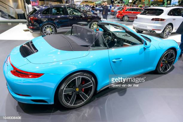 Porsche 911 Cabriolet convertible sports car on display at Brussels Expo on January 13, 2017 in Brussels, Belgium. The iconic Porsche 911, generation...