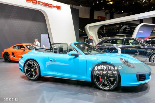 Porsche 911 Cabriolet convertible sports car on display at Brussels Expo on January 13 2017 in Brussels Belgium The iconic Porsche 911 generation 991...