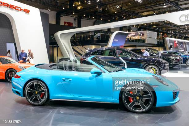 Porsche 911 Cabriolet convertible sports car side view on display at Brussels Expo on January 13 2017 in Brussels Belgium The iconic Porsche 911...