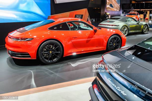 Porsche 911 Carrera 2 Coupé sports car in red on display at Brussels Expo on January 9 2020 in Brussels Belgium The Porsche 992 is the eighth...