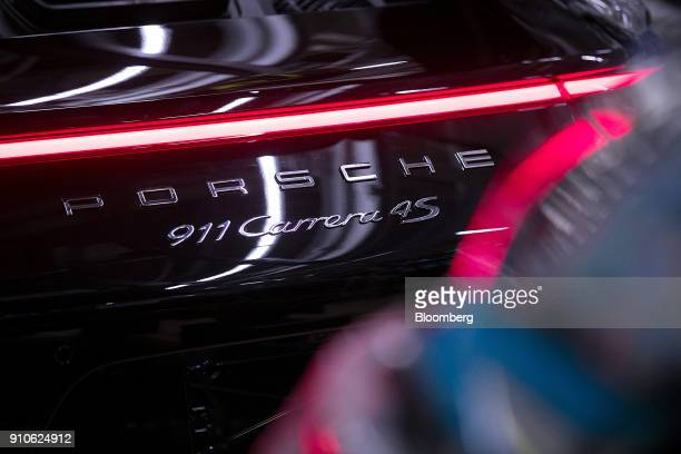 A Porsche 911 Carrera 4S luxury automobile stands on the production line inside the Porsche AG factory in Stuttgart Germany on Friday Jan 26 2018...