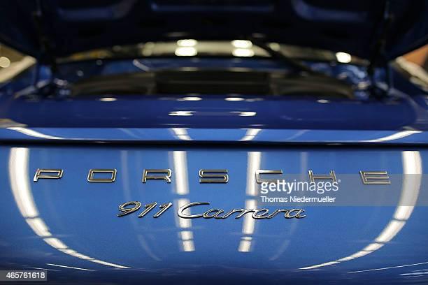 Porsche 911 Carrera lettering is seen at the Zuffenhausen Porsche production plant on March 10 2015 in Stuttgart Germany Porsche will announce the...