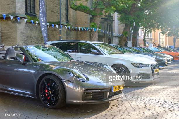 porsche 911 carrera s cabriolet 992 sports car and audi rs6 avant performance station wagon - audi a6 avant stock photos and pictures