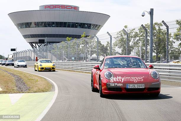 Porsche 911 Carrera S drive the Porsche onroad race track during the 'Porsche Experience For Women' Event on July 11 2016 in Leipzig Germany