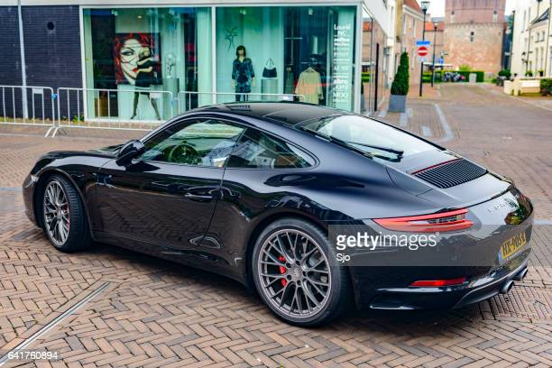 Porsche 911 CARRERA S parked on a city street