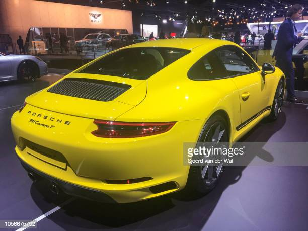 Porsche 911 Carrera T sports car in bright yellow on display at Brussels Expo on January 10 2018 in Brussels Belgium The 911 Carrera T is a version...
