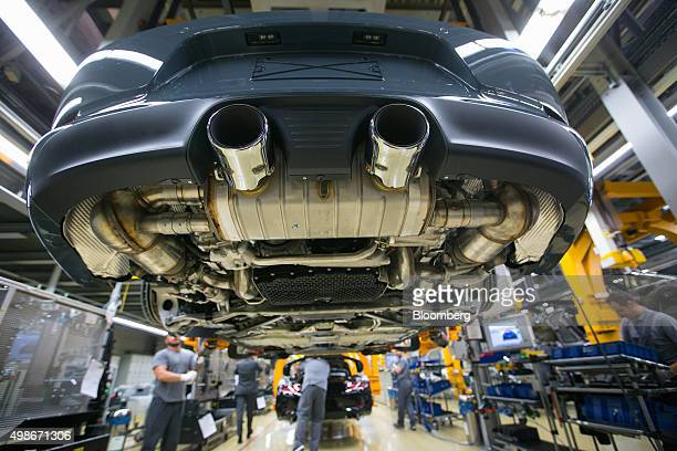Porsche 911 luxury automobiles pass along the assembly line at Porsche AG's factory operated by Volkswagen AG in Stuttgart Germany on Tuesday Nov 24...