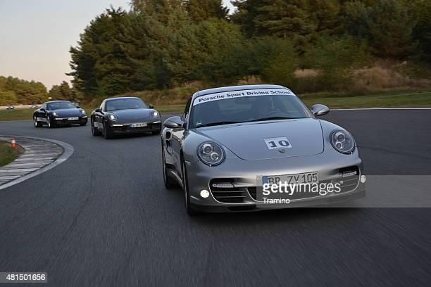 porsche 911 on the racetrack - porsche stock pictures, royalty-free photos & images