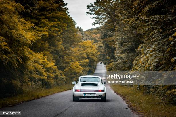porsche 911 on the road - porsche stock pictures, royalty-free photos & images