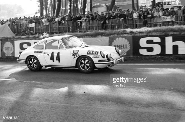 Porsche 911 on the track racing Le Mans 1968 Team August Veuillet Guy Chasseuil Claude BallotLéna #44 Position 22 Le Mans 1968 24 hour endurance race...