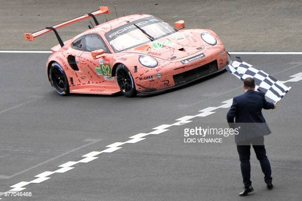 Porsche 911 RSR WEC crosses the finish line to win the LMGTE pro category of the 86th Le Mans 24hours endurance race at the Circuit de la Sarthe on...