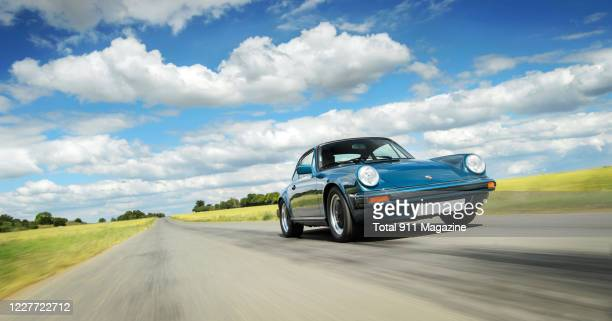 Porsche 911 SC photographed driving on a track in Essex, on July 2, 2019.