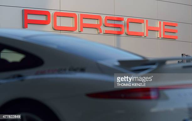 A Porsche 911 sportscar stands in front of the headquarters of German car producer Porsche in Stuttgart southwestern Germany on March 11 2014 AFP...