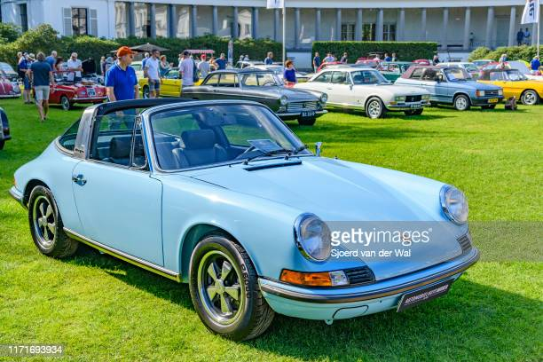 Porsche 911 Targa 2.4 T classic sports car with removalbe hardtop on display at the 2019 Concours d'Elegance at palace Soestdijk on August 25, 2019...