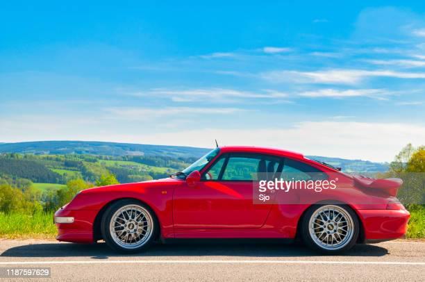 porsche 911 turbo in ländlicher landschaft - porsche 911 stock-fotos und bilder