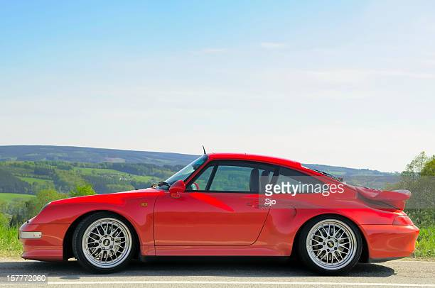 Porsche 911 Turbo sports car in a landscape with hills