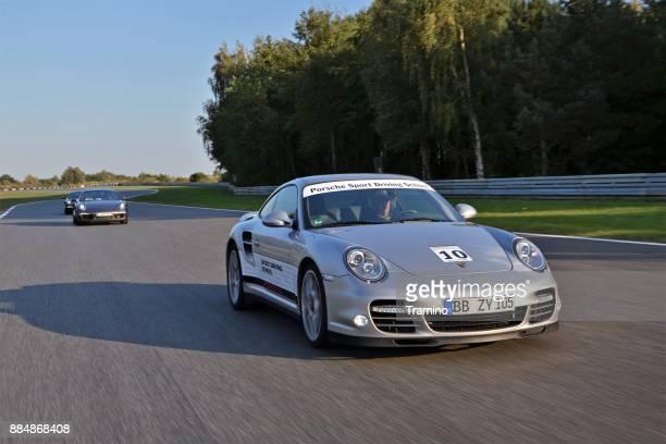 Porsche 911 vehicles on the racetrack