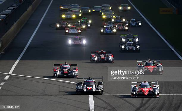 Porsche 919 Hybrid from the team of Timo Bernhard of Germany, Mark Webber of Australia and Brendon Hartley of New Zealand, is pictured at the start...