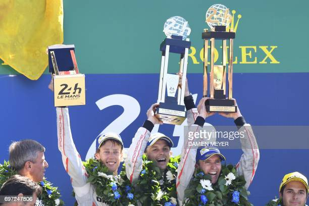 Porsche 919 Hybrid N°2 team Germany's driver Timo Bernhard New Zeland's driver Earl Bamber and New Zeland's driver Brendon Hartley celebrate on the...