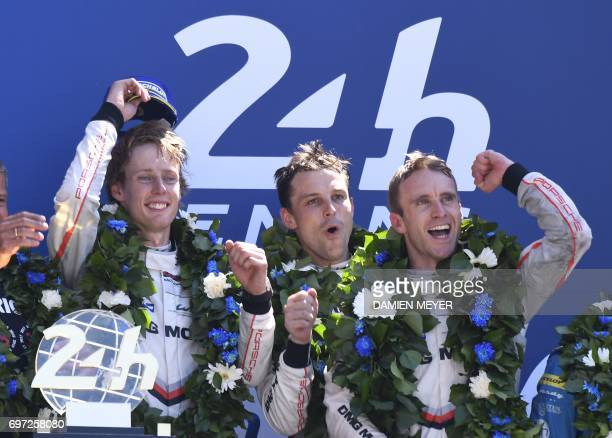 Porsche 919 Hybrid N°2 team Germany's driver Timo Bernhard New Zeland's driver Earl Bamber and New Zealand's driver Brendon Hartley celebrate on the...