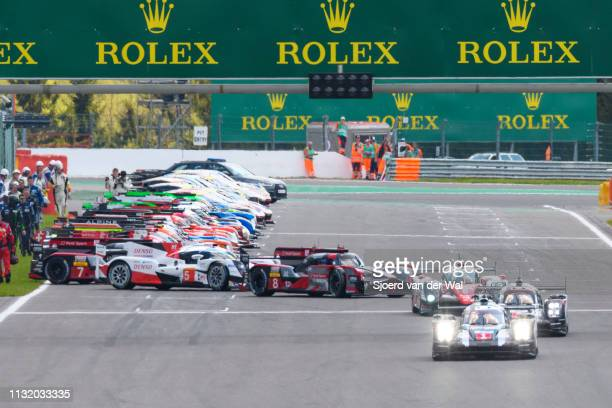 Porsche 919 Hybrid on pole position at the start grid with the rest of the field including the Toyota TS050 Hybrid and Audi R18 following from the Le...