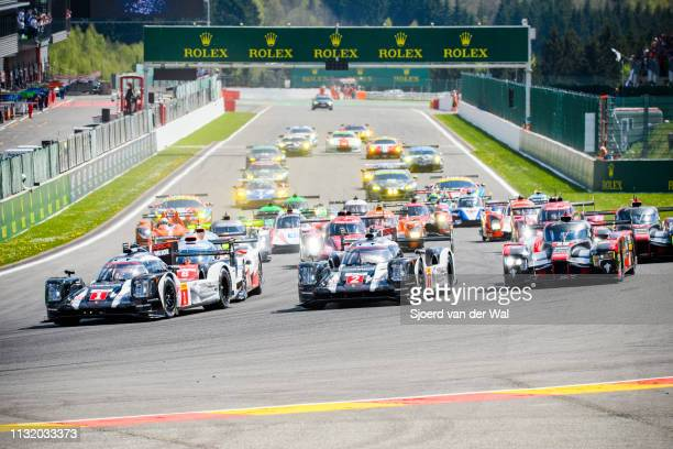 Porsche 919 Hybrid on pole position at the start grid with the rest of the field including the Toyota TS050 Hybrid and Audi R18 following at the...