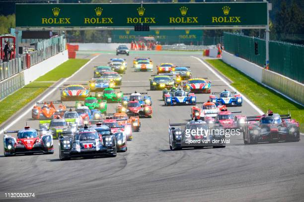 Porsche 919 Hybrid on pole position at the start grid with the rest of the field, including the Toyota TS050 Hybrid and Audi R18, following at the...