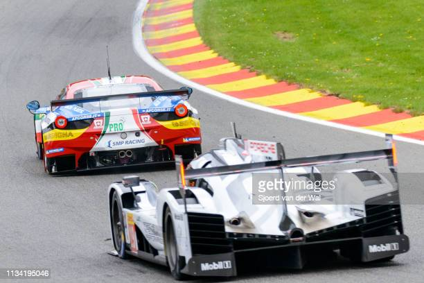 Porsche 919 Hybrid sportsprototype and AF Corse Ferrari 458 Italia GT racing cars driving through Eau Rouge up Raidillon on track during the 6 Hours...