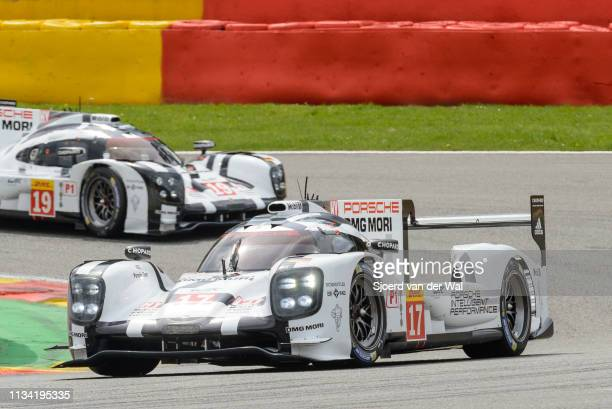 Porsche 919 Hybrid sportsprototype racing car driven by BERNHARD T WEBBER MHARTLEY B with the Porsche 919 following in the background on track during...