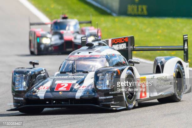 Porsche 919 Hybrid sportsprototype racing car of Romain Dumas Neel Jani and Marc Lieb driving on track with an Audi Sport Team Joest R18 etron...